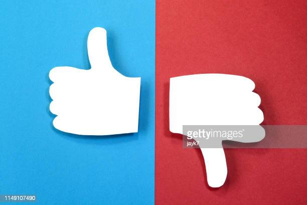 thumbs up and down - negative emotion stock pictures, royalty-free photos & images