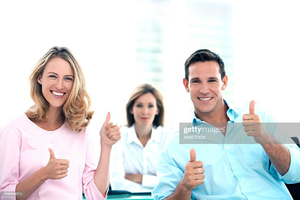Thumbs up at the Bank : Stock Photo