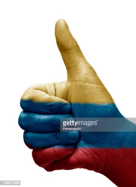 pulgares arriba colombia - bandera colombiana fotografías e imágenes de stock