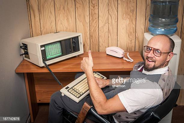 thumbs up computer worker nerd  on phone at cubicle - obsolete stock pictures, royalty-free photos & images