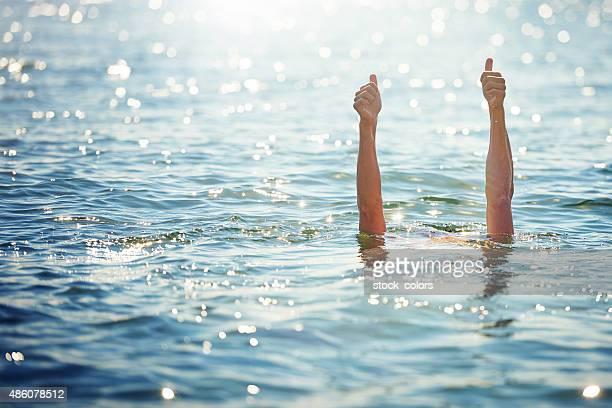 thumbs up for swimming - tummen upp bildbanksfoton och bilder