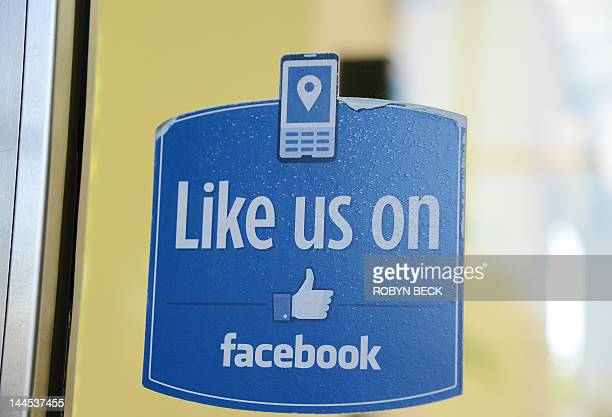 A thumbs up 'Like' icon is on the door at the entrance to Building 10 at Facebook headquarters in Menlo Park California May 15 2012 Facebook the...