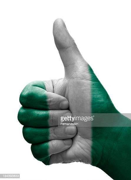 thumbs up nigeria - nigerian flag stock photos and pictures