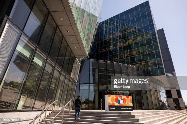 A thumbs up symbol stands at the entrance to the Facebook Inc European headquarters in Dublin Ireland on Wednesday June 6 2018 Companies are...