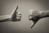 Thumbs up thumbs down.