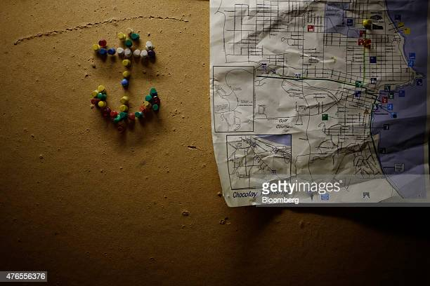 Thumbtacks arranged in the shape of an anchor are pictured on a bulletin board below deck on the Manitowoc, a lake freighter with Rand Logistics Inc....
