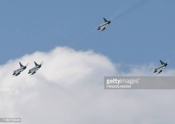 PAC JF17 'Thunder' aircrafts fly during the rehearsal of the Pakistan National Day army parade in Islamabad on March 15 2019 Pakistan will celebrate...