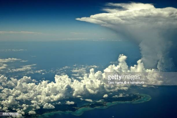Thunder cloud and Ishigaki Island in Okinawa in summer daytime aerial view from airplane