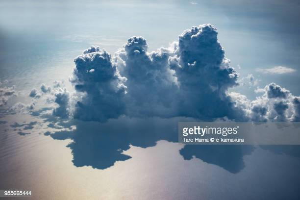 Thunder clouds on South China Sea daytime aerial view from airplane