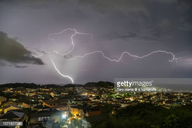 thunder clouds on the residential district by the sea in kanagawa prefecture of japan - kanagawa prefecture stock pictures, royalty-free photos & images