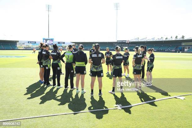 Thunder coach Jo Broadbent talks to players before the Women's Big Bash League match between the Sydney Thunder and the Hobart Hurricanes at the...