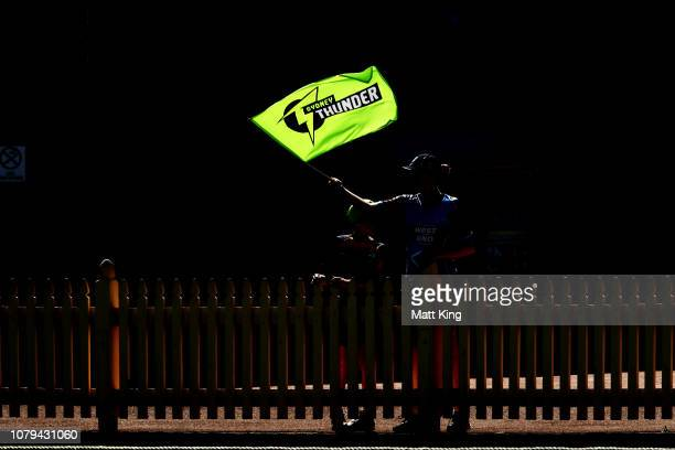 Thunder fans support during the Women's Big Bash League match between the Sydney Thunder and the Brisbane Heat at North Sydney Oval on December 09,...