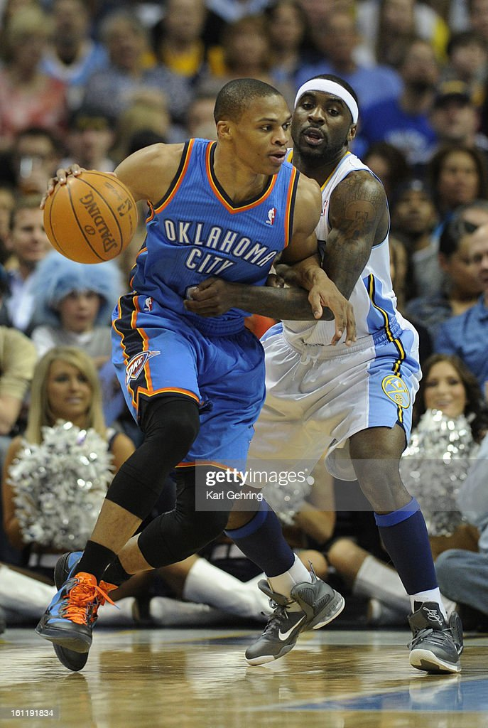 Thunder guard Russell Westbrook (0) worked around Denver defender Ty Lawson (3) in the second half. The Denver Nuggets fell to the Oklahoma City Thunder 103-90 at the Pepsi Center, Thursday night, March 15, 2012. Karl Gehring/The Denver Post : News Photo