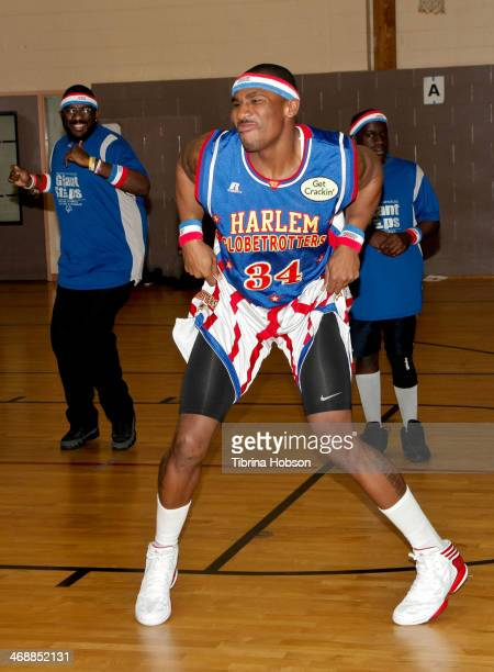 Thunder Law of the Harlem Globetrotters and Mark Ballas team up for Special Olympics at Weingart East Los Angeles YMCA on February 11 2014 in Los...