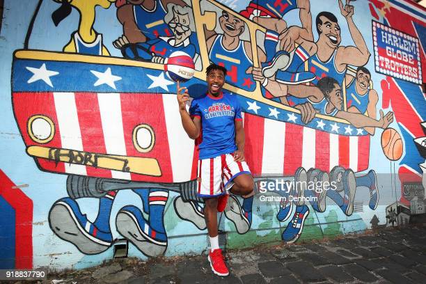 Thunder of the Harlem Globetrotters poses next to a Harlem Globetrotters graffiti mural during a media opportunity on February 16 2018 in Melbourne...