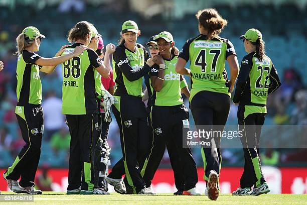 Thunder players celebrate their win on count back after the super overs during the Women's Big Bash League match between the Sydney Sixers and the...