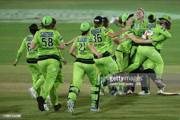Thunder players celebrate victory during the Women's Big Bash League Final between the Melbourne Stars and the Sydney Thunder at North Sydney Oval,...