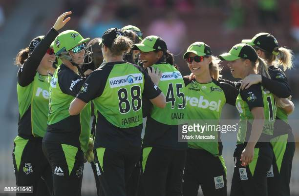 Thunder players celebrate victory during the Women's Big Bash League WBBL match between the Melbourne Renegades and the Sydney Thunder at North...