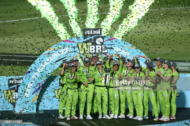 Thunder players celebrate with the trophy after victory during the Women's Big Bash League Final between the Melbourne Stars and the Sydney Thunder...