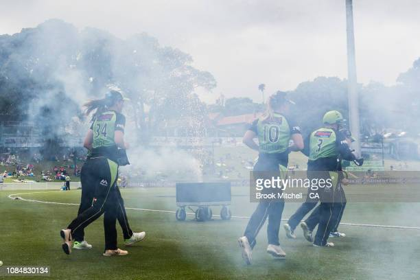 Thunder players hit the field during the Women's Big Bash League Semi Final against the Brisbane Heat on January 19 2019 in Sydney Australia