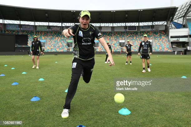 Thunder players warm up before the Women's Big Bash League match between the Sydney Thunder and the Adelaide Strikers at Blundstone Arena on December...