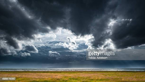 thunder storm clouds - dramatic sky stock pictures, royalty-free photos & images