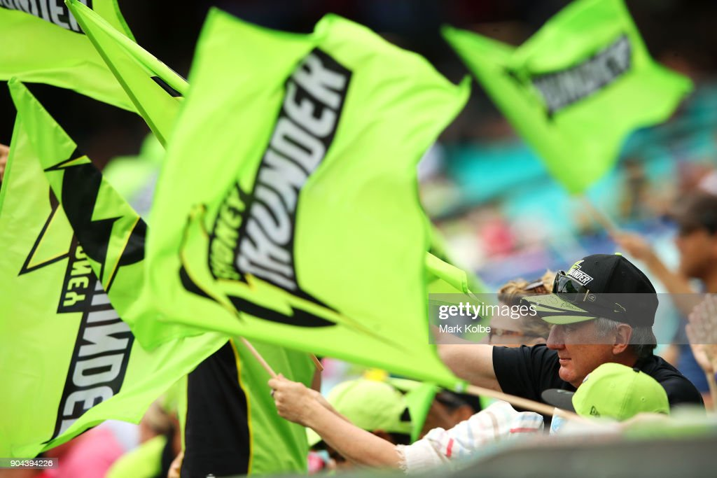 Thunder supporters cheer during the Women's Big Bash League match between the Sydney Sixers and the Sydney Thunder at Sydney Cricket Ground on January 13, 2018 in Sydney, Australia.