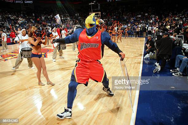 Thunder the mascot of the Golden State Warriors pumps up the crowd before the game against the Houston Rockets on December 14 2005 at the Arena in...