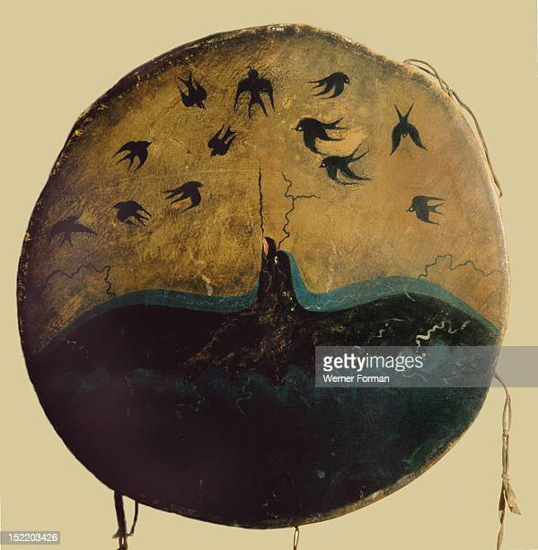 A thunderbird mythical creator of Plain storms swoops out of the sky hurling lightning flashes at darting swallows on this graphic Pawnee ceremonial...