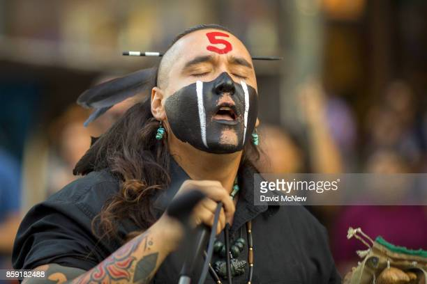 Thunderbird performs with the indigenous band Aztlan Underground on Hollywood Boulevard during an event celebrating Indigenous Peoples Day in the...