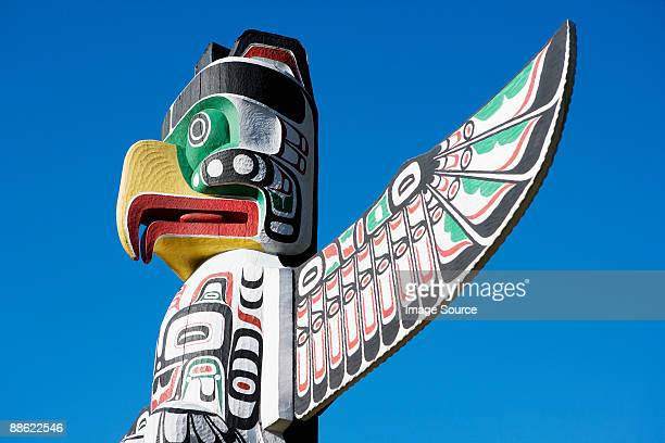 thunderbird totem pole in stanley park - totem pole stock photos and pictures