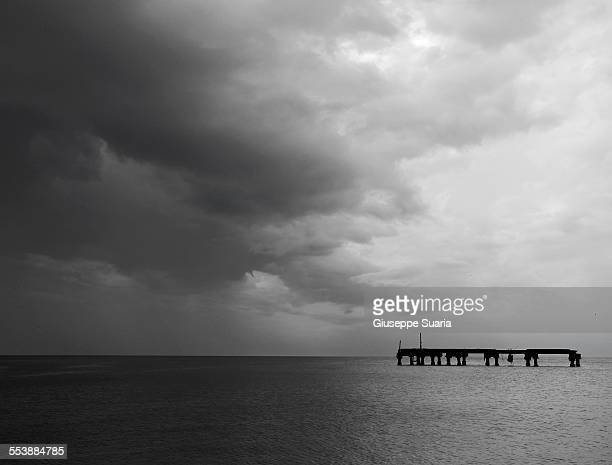 thunderclouds on the black sea - pontoon bridge stock pictures, royalty-free photos & images