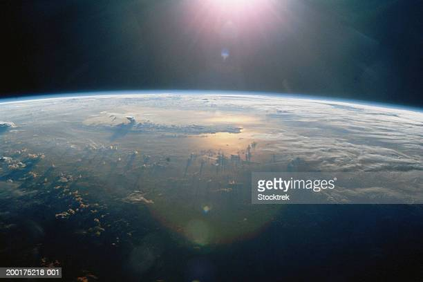 thunderclouds over pacific ocean at sunset, view from satellite - satellitenaufnahme stock-fotos und bilder