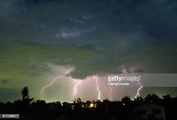 Thunderhead lightning bolts strikes over Denver Colorado neighborhood homes