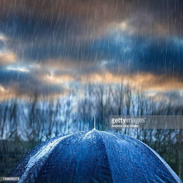 Thunderstorm and rainfall above an umbrella