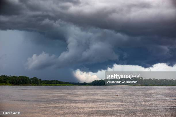 thunderstorm drama over the amazon river - river amazon stock pictures, royalty-free photos & images