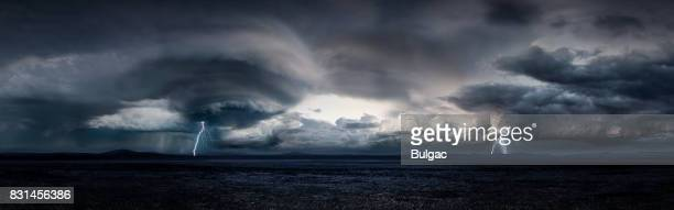 thunderstorm in a large desert (day) - nube temporalesca foto e immagini stock