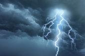 Thunderstorm lightning with dark cloudy sky