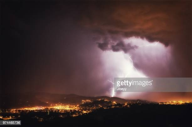 thunderstorm over city, saint-etienne, france - auvergne rhône alpes stock pictures, royalty-free photos & images