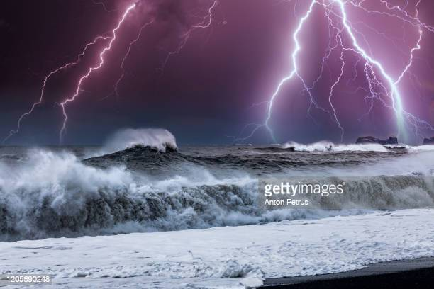 thunderstorm over storm waves on the sea with dramatic clouds - rock formation stock pictures, royalty-free photos & images