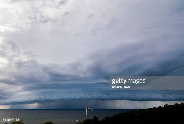 thunderstorm over the baltic sea - extreme weather stock photos and pictures