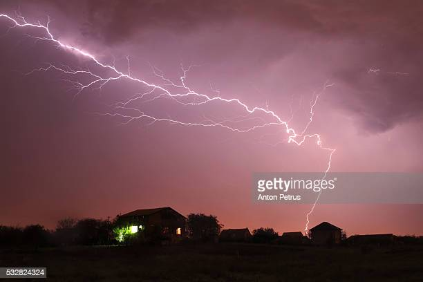 Thunderstorm over the house at night