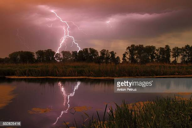 Thunderstorm over the river at night