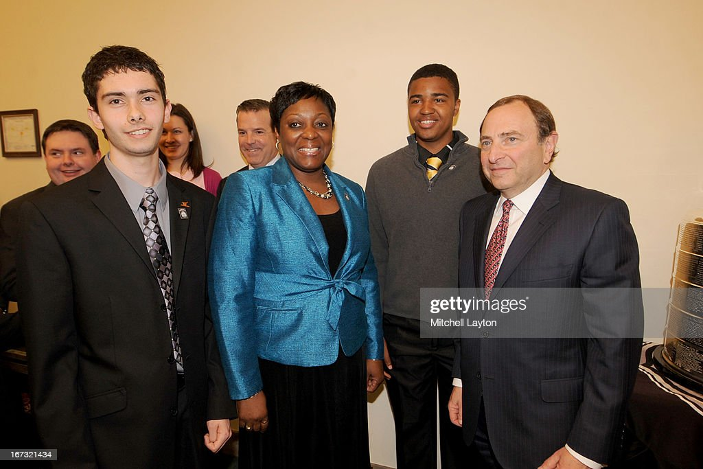 Thurgood Marshall College Fund winner Richard Lucas, Thurgood Marshall College Fund Financial Officer Velma R. Hart, winner Donald Shaw III and NHL Commissioner Gary Bettman pose for a picture before a Congressional Hockey Caucus briefing at the Rayburn Building on April 24, 2013 at Nationals Park in Washington, DC.