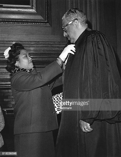 Thurgood Marshall gets a last minute check from his wife Cecilia Suyat before his swearing in at the Supreme Court in 1967 Marshall was the first...