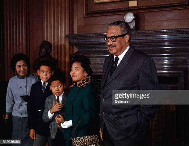 Thurgood Marshall stands with his family prior to being sworn in as the first black member of the US Supreme Court Left to right are his sisterinlaw...