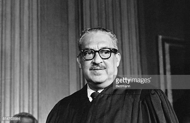 Thurgood Marshall the greatgrandson of a slave takes his seat as the first black member of the United States Supreme Court