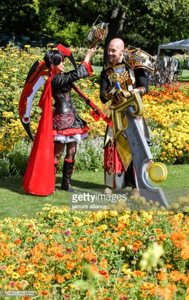 """Thuringia, Erfurt: Stella from Arnstadt as Ruby Rose and Florian from Jena as Paladin prepare for a photo shoot at the event """"Comic- und Mangapark""""..."""
