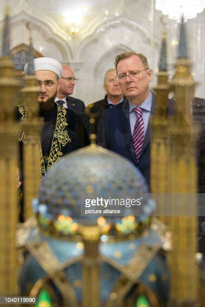 Thuringian State Premier Bodo Ramelow and Imam Ilfat Khasanov look at a model of the mosque in the Qolsarif Mosque in Kazan Russia 20 April 2016...