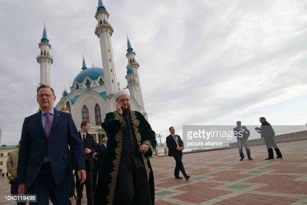 Thuringian State Premier Bodo Ramelow and Imam Ilfat Khasanov walk across the square at the Qolsarif Mosque in Kazan Russia 20 April 2016...